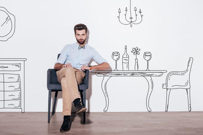 Мужчина сидит в нарисованной кухне