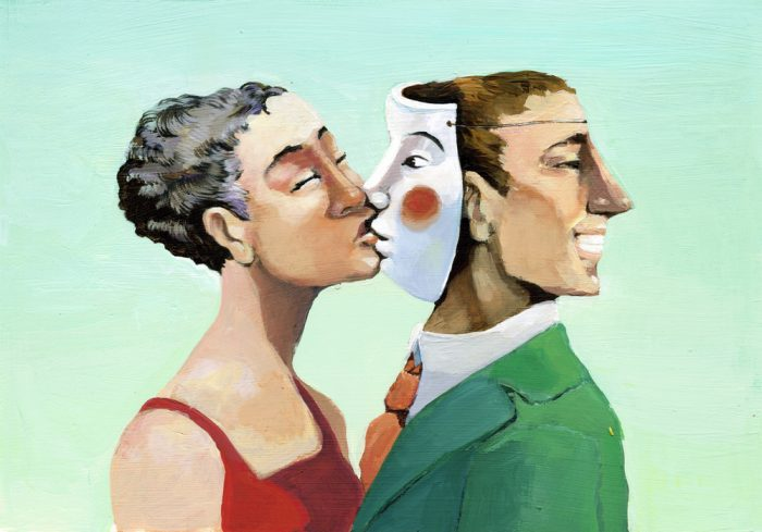 Девушка целует маску на мужчине