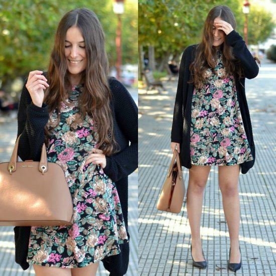 Девушка в коротком платье и длинной черной кофте