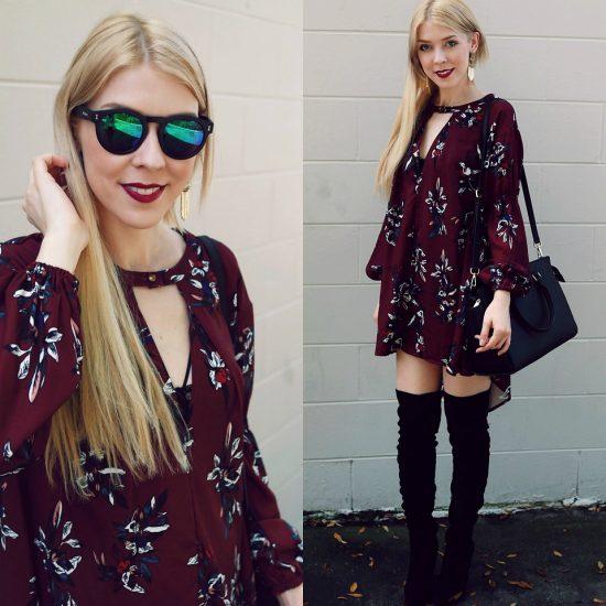 Девушка в платье цвета бордо в цветочек и в высокий сапогах