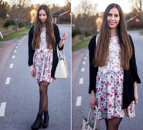 Девушка в светлом платье в цветочек, черной кофте и с сумкой