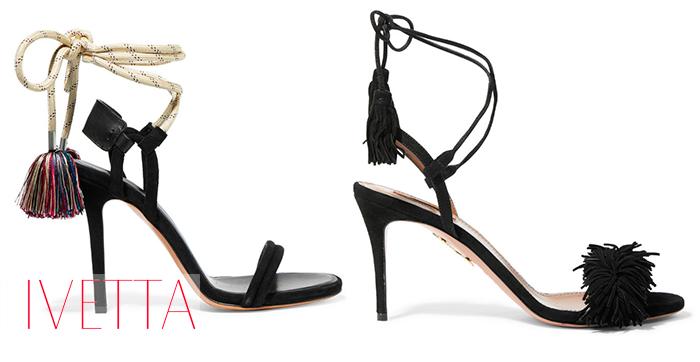 Пара черных женских босоножек на высоком каблуке