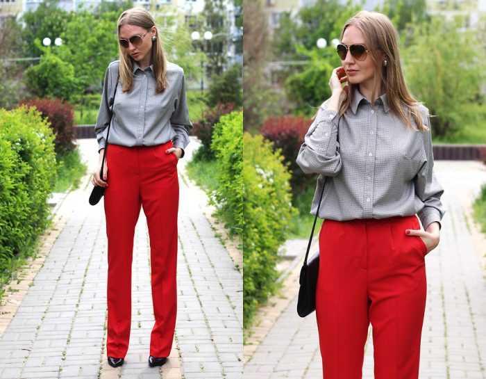 Девушка в серой рубашке и красных брюках