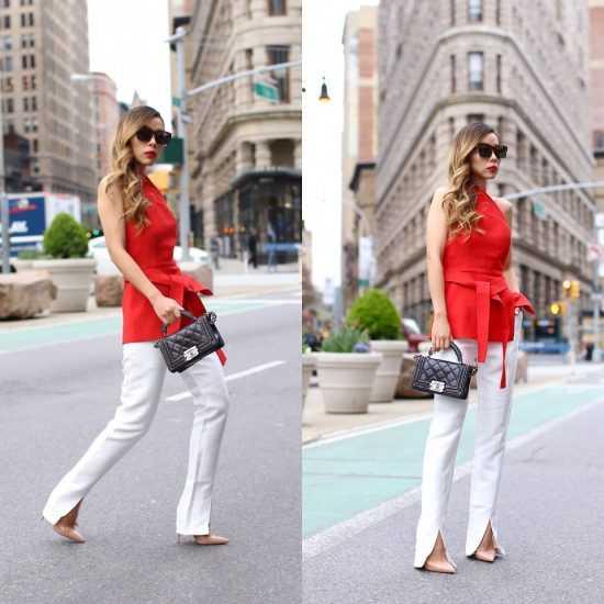 девушка в красной кофте и белых брюках