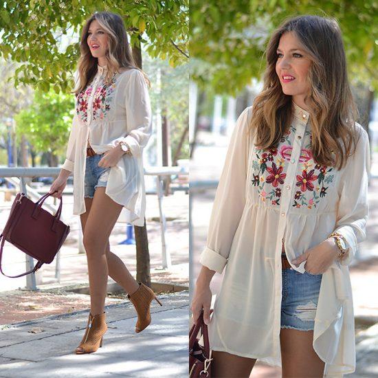 Девушка в длинной светлой рубашке вышиванке и в шортах