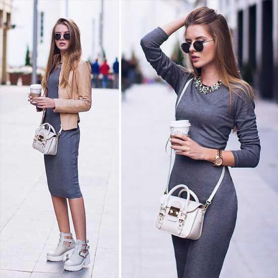 Девушка в очках и в сером платье ниже колен