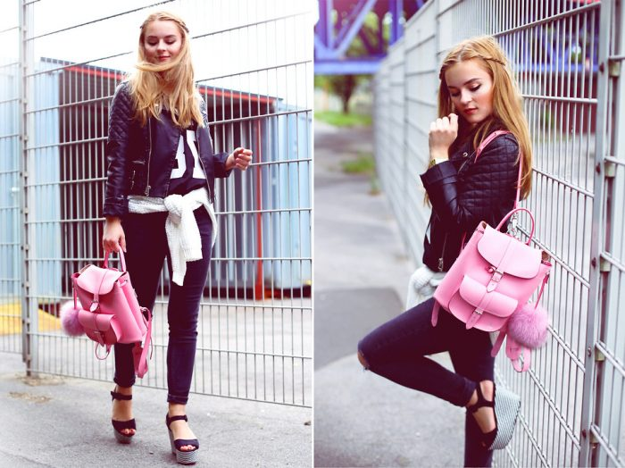 Девушка в черных джинсах,черной ветровке и с розовым рюкзаком