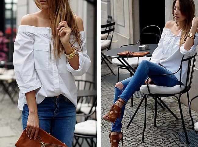 Девушка в джинсах с высокой талией и белой кофте с открытыми плечами