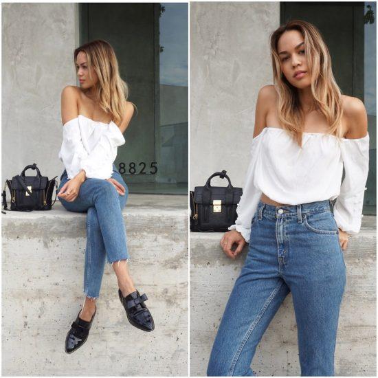 Девушка в джинсах с высокой талией и белой кофте