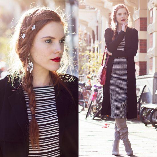 Девушка в клетчатой юбке, полосатой кофте и в черном кардигане