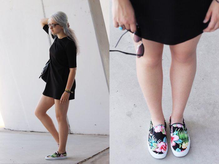 Девушка в коротком черном платье и в слипонах с цветочным принтом