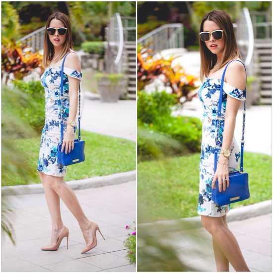 девушка в платье с открытыми плечами и с голубой сумкой
