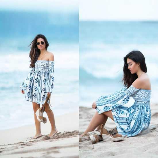 Девушка в платье с открытыми плечами на пляже