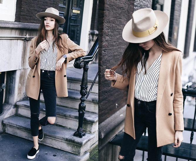 Девушка в джинсах,пиджаке и в шляпе