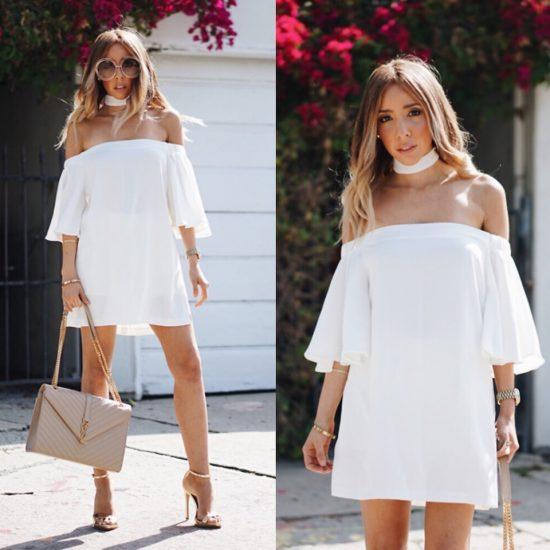 Девушка в белом платье и белой повязкой нашее