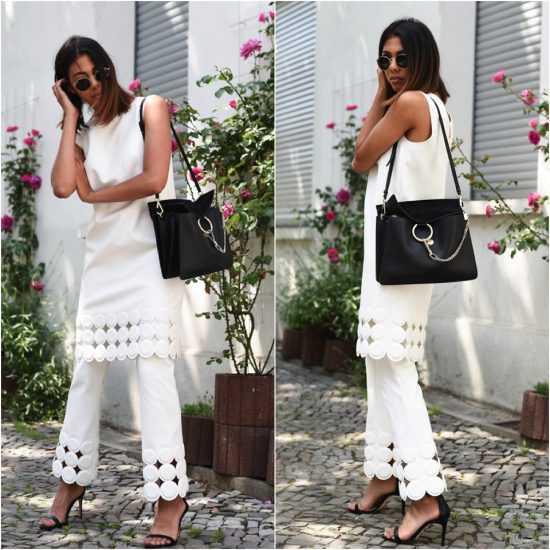 девушка в белом костюме и с черной сумкой