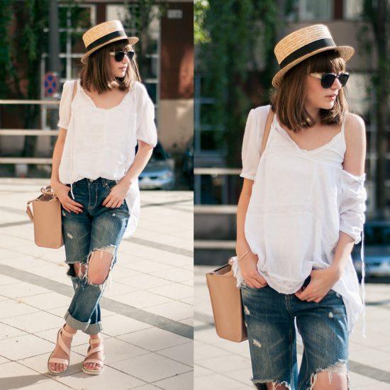 Девушка в светлой кофте и порванных джинсах
