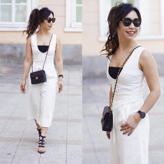 Девушка в черном топе и белом костюме