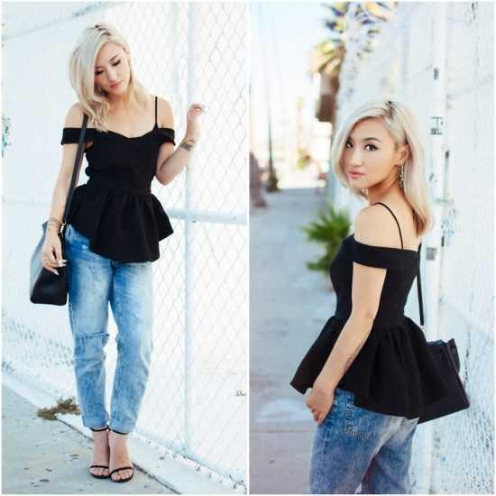 Девушка в джинсах и черной кофте