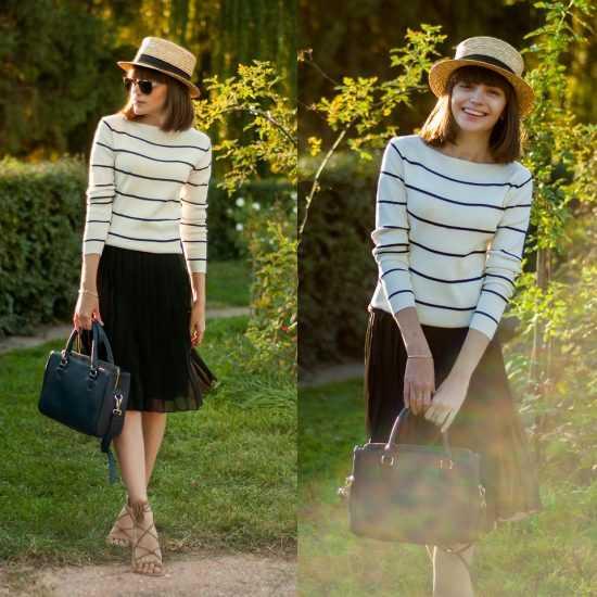 Девушка в олосатом свитере и черной юбке поколено
