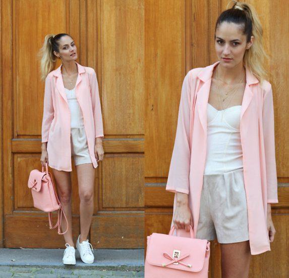 девушка в белых шортах, майке и в розовом пиджаке
