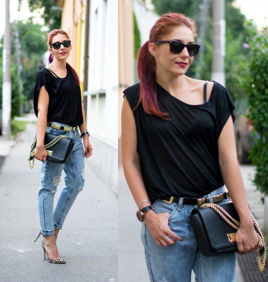 Девушка в джинсах-бойфрендах и черной майке