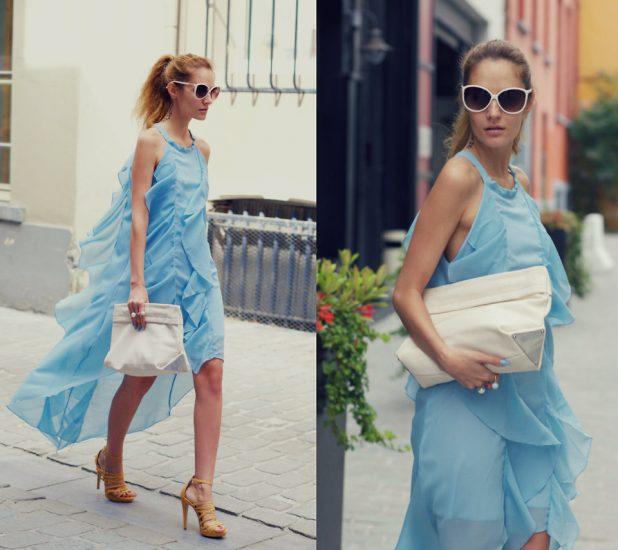 Девушка в голубом платье и с белой сумкой