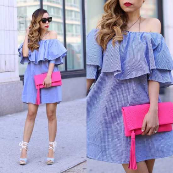 Девушка в фиолетовом платье и с розовой сумкой
