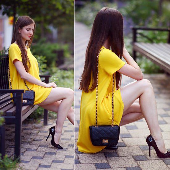Девушка в коротком желтом платье и с черным клатчем