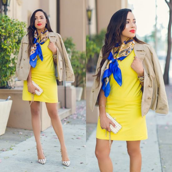 Девушка в коротком желтом платье и с шарфиком на шее