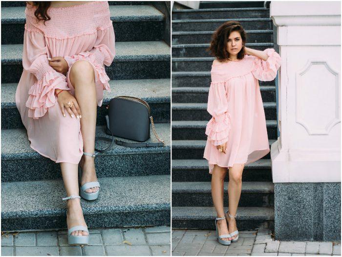 Девушка в розовом платье и с черной сумкой