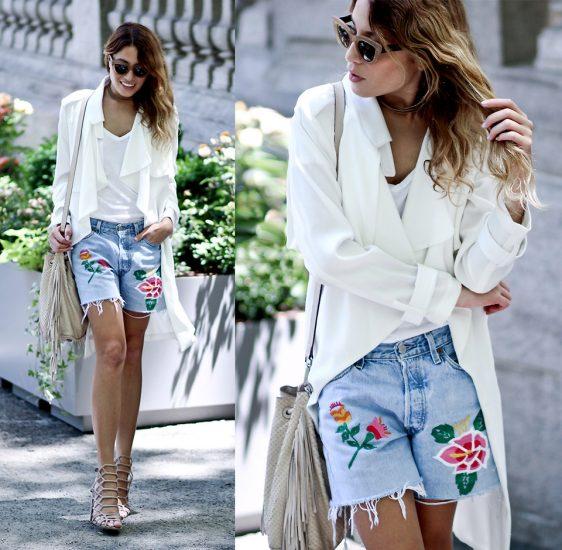 Девушка в шортах с вышивкой и белом пиджаке