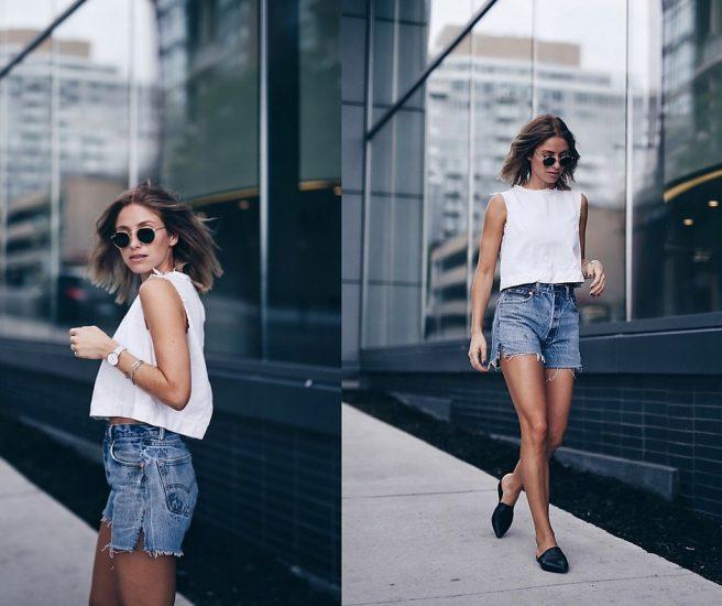 Девушка в темных очках, в шортах и белой майке