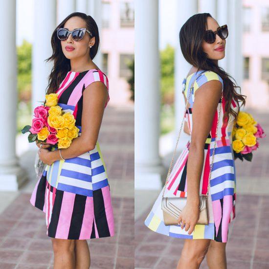 Девушка в платье в цветную полоску