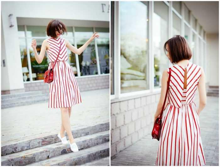 Девушка в платье в красную полоску