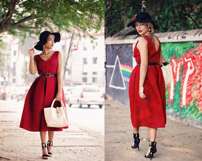 девушка в черно шляпе и в красном платье