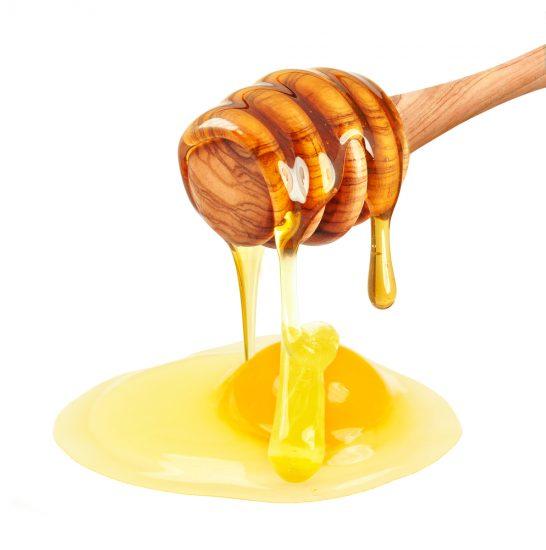 Желток и палочка с медом